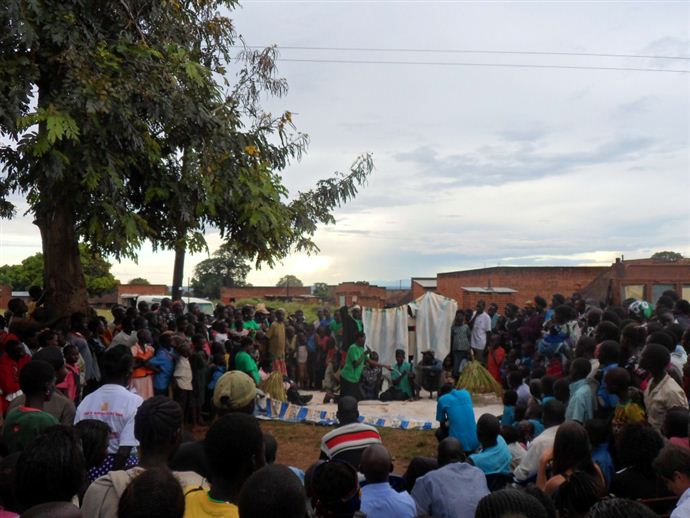 Group members on the South Sudanese border performing a play about how to solve land conflicts to their fellow community members.