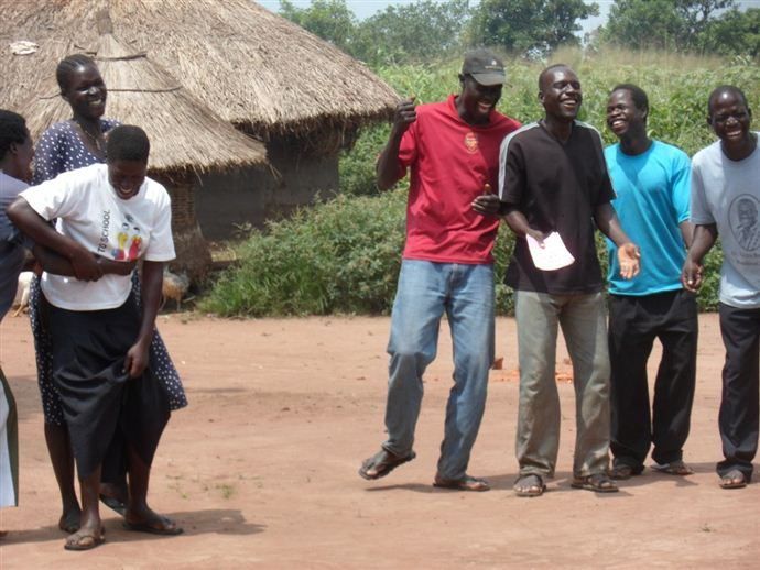 Members of Can Deg Wor (meaning 'Poverty needs no quarrel') sharing a joke while on a group activity.